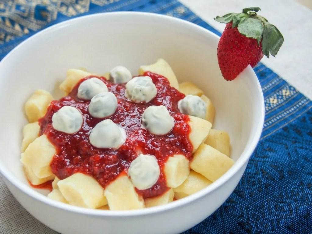 Dessert gnocchi with balsamic strawberry sauce