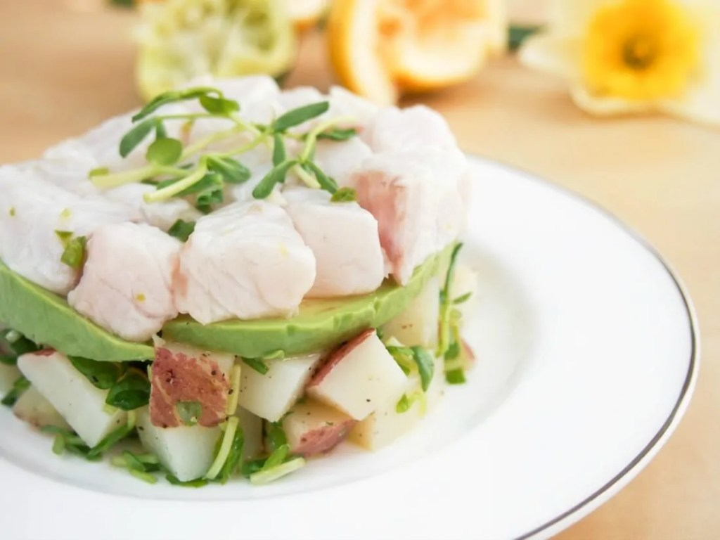 Ceviche with potato and pea shoot salad