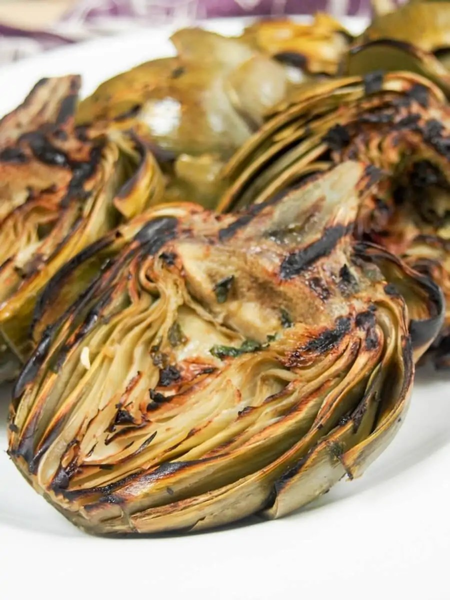 Artichokes may seem a little fiddly, but they are so worth the effort, especially when they taste as good as these grilled artichokes. The grilling flavor and garlic-herb oil makes all the difference. A great appetizer.