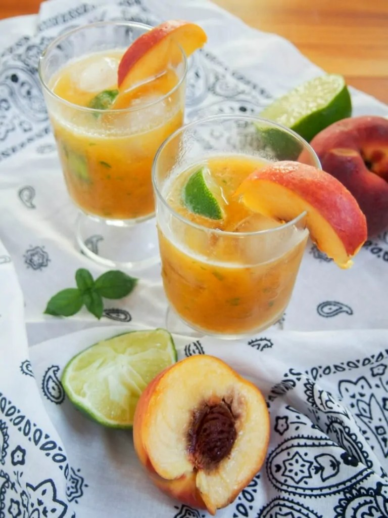 This basil peach margarita is deliciously fresh and fruity, easy to make and all too easy to enjoy. Perfect for taco Tuesday, parties or just because.