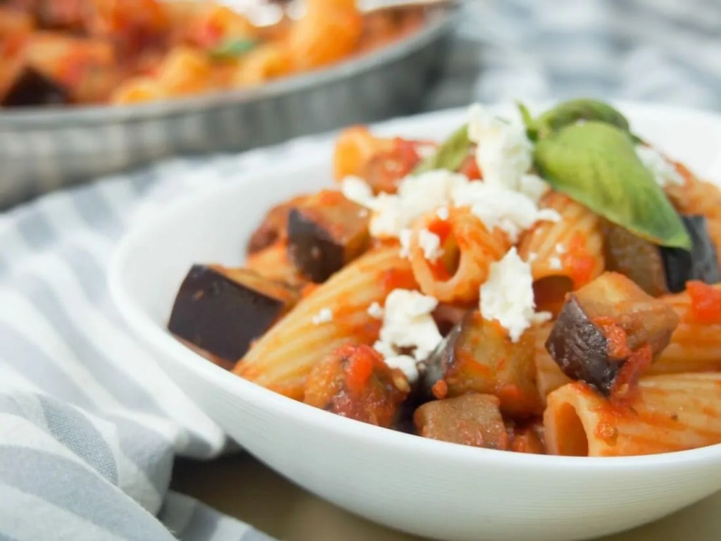 Pasta alla Norma is a simple combination of eggplant, tomato sauce and topped with ricotta salata, but it's a winning formula. Easy to make, easy to enjoy. A great easy meal. @Walmart #AD #PickedAtPeak