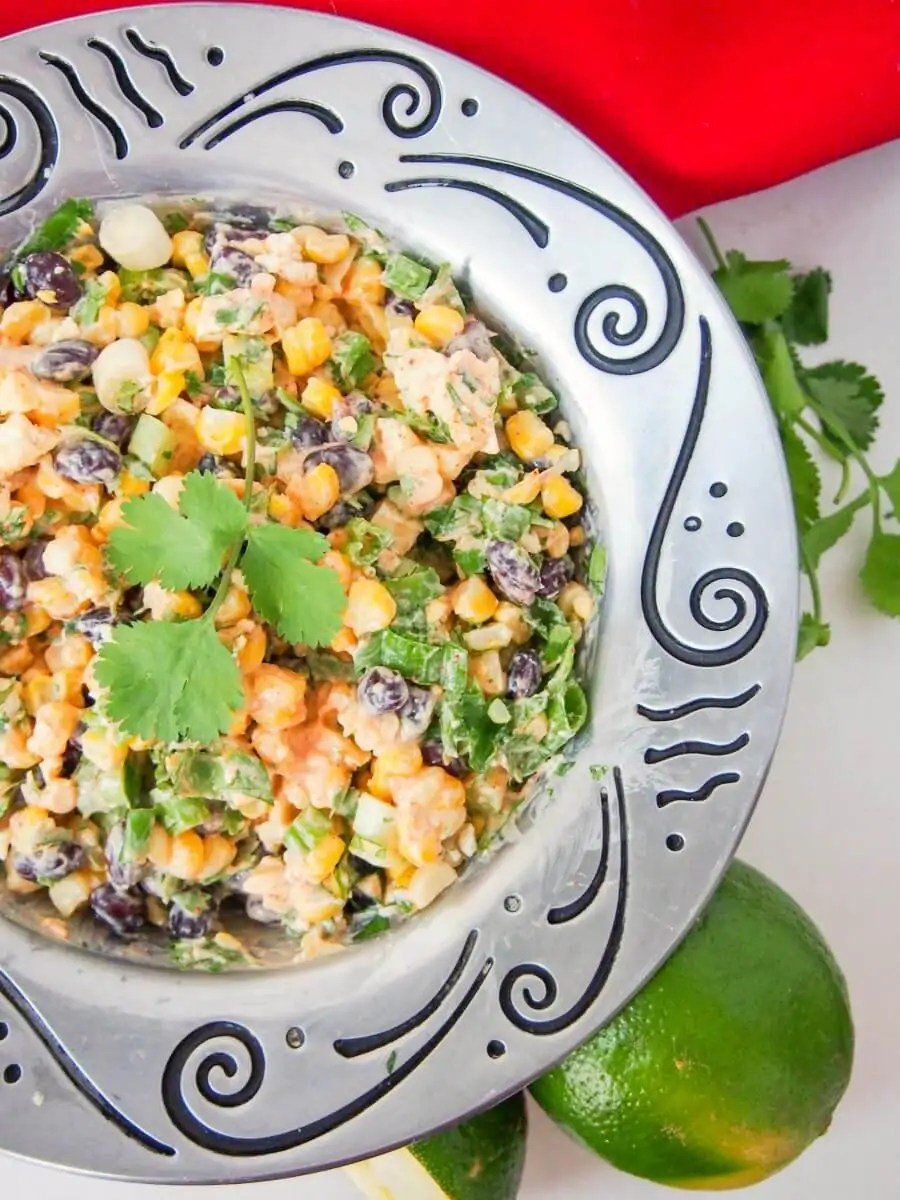 This Mexican street corn salad is easy to prepare and packed with delicious fresh flavors. With a healthier dressing, it makes a great side or potluck salad. Vegetarian