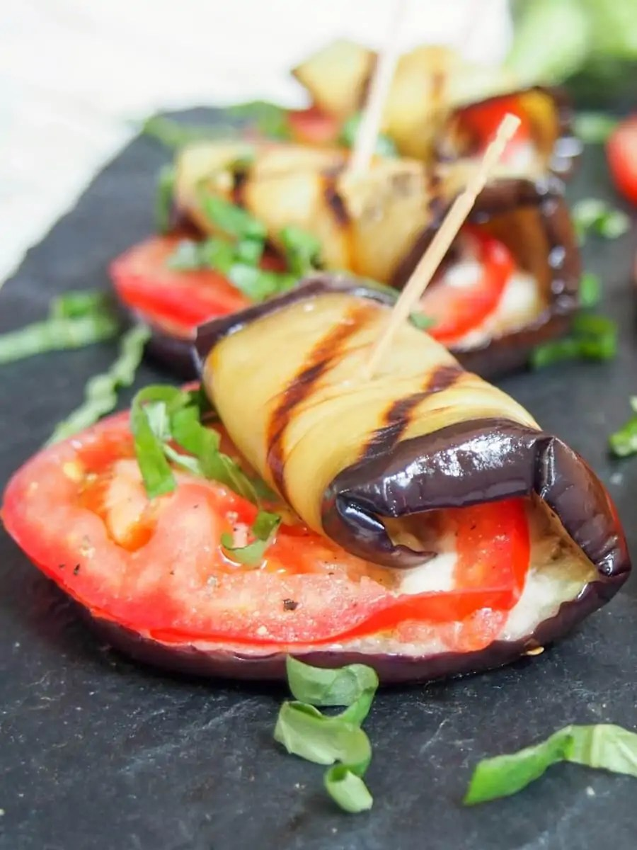 These caprese eggplant roll ups are easy to make and make a great appetizer or snack. Great fresh flavors, gooey cheese: a great simple combination.