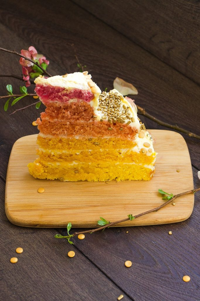 AMAZING easter and/or birthday ombre cake! Rich layers of white chocolate mousse and zesty lemon frosting on a coconut sponge base.
