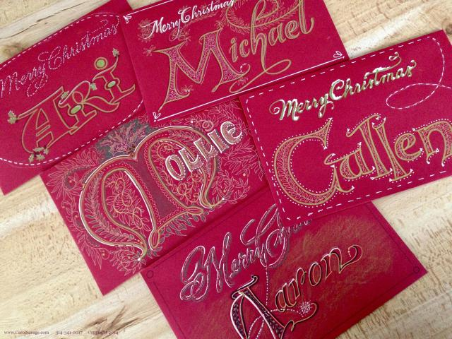 Hand-lettered red envelopes feature lots of dots and dashes, plus strands of traditional leafy wreaths and vines were details I placed inside decorated initial letters. A variety of pens gave differing line widths.