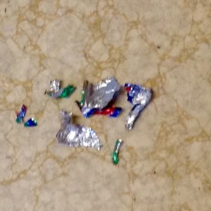 Discarded foil egg wrappers.