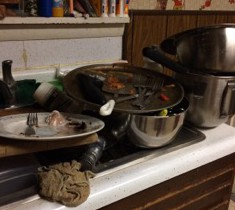 Sink full of dirty dishes.