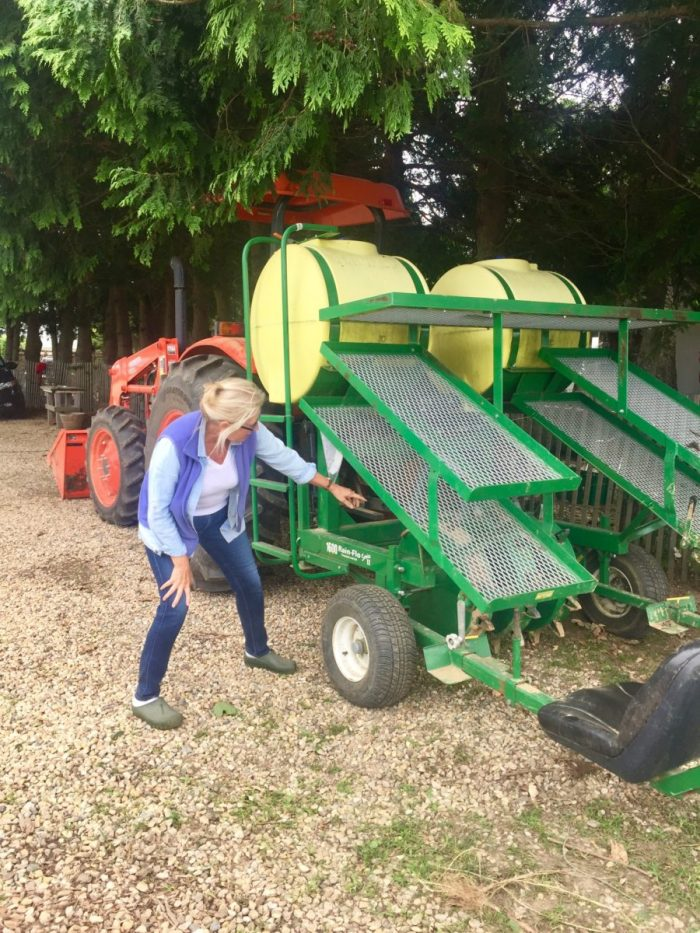 Denise showing me the seeding machine at Amber Waves Farm