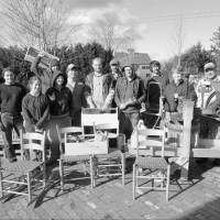 apprentices with toolboxes and chairs they made