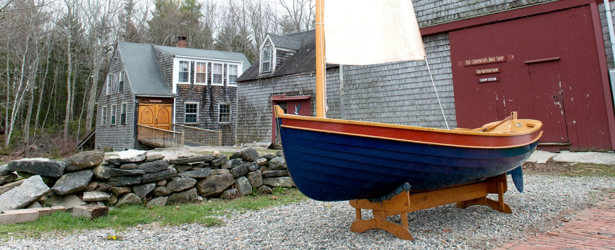 catspaw dinghy in front of barn