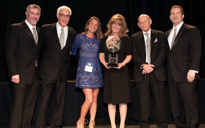 Stacey Pape and Veronica Sutyak receiving the CarpetsPlus COLORTILE Retailer of the Year Award.