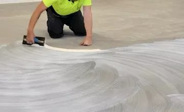 to lay carpet tiles on tackifier adhesive