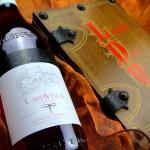 Rosato Ressia accanto a lista dei vini