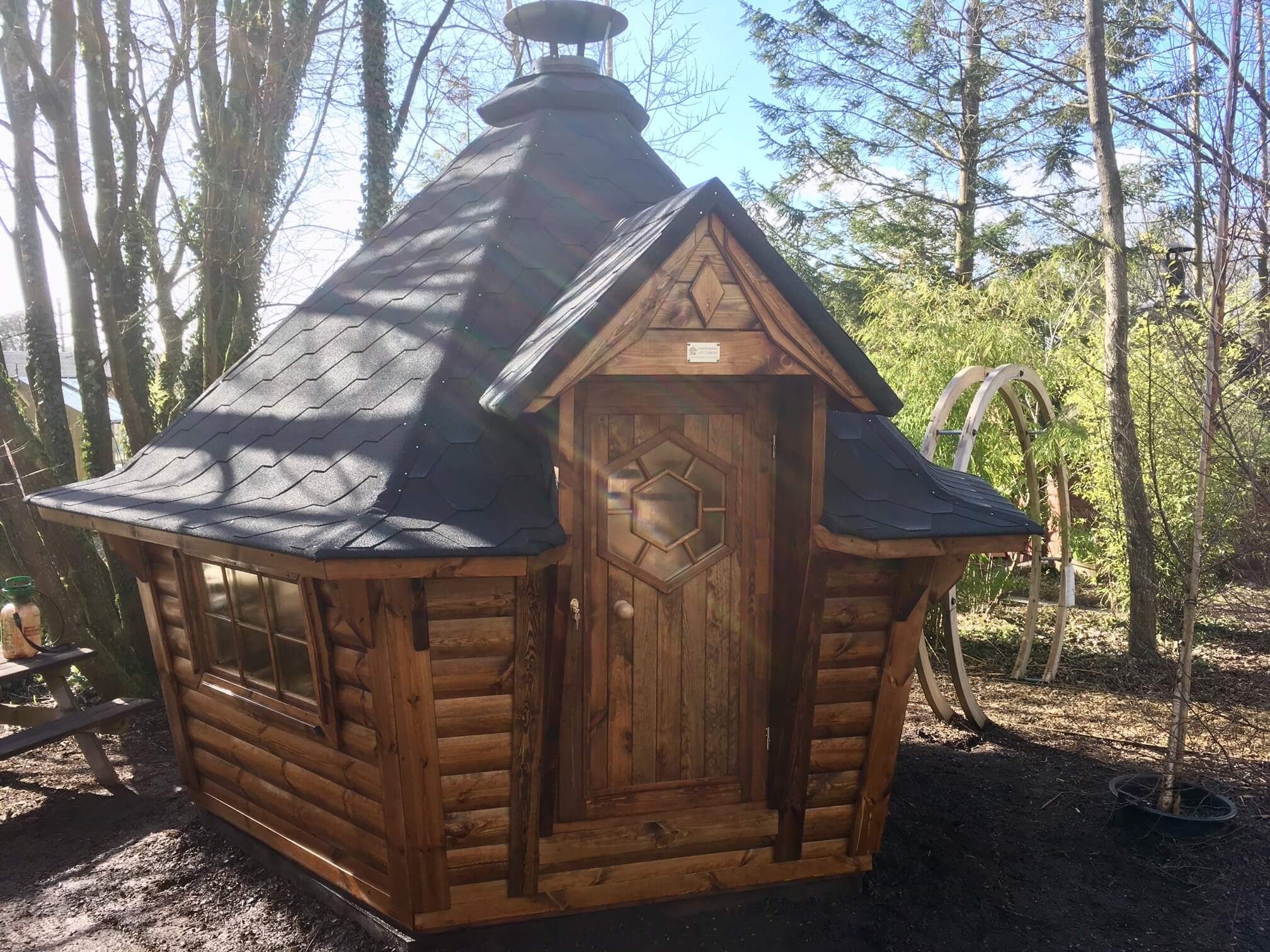 7m Sloping Wall BBQ Cabin at Carr Bank Garden Centre