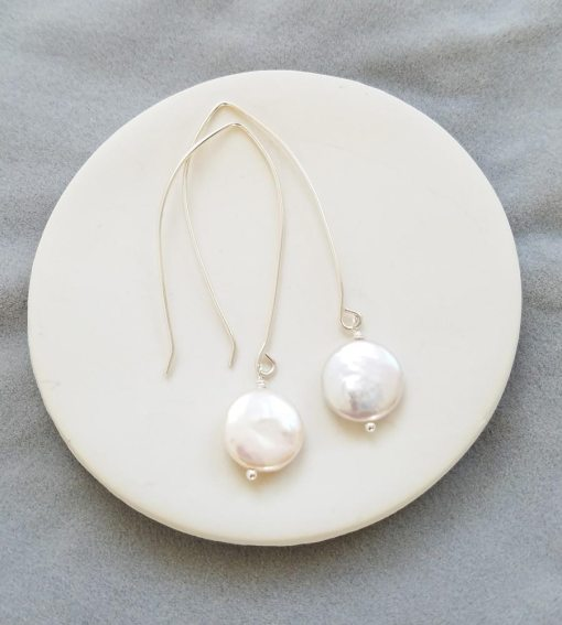 Handmade long dangle coin pearl earrings by Carrie Whelan Designs
