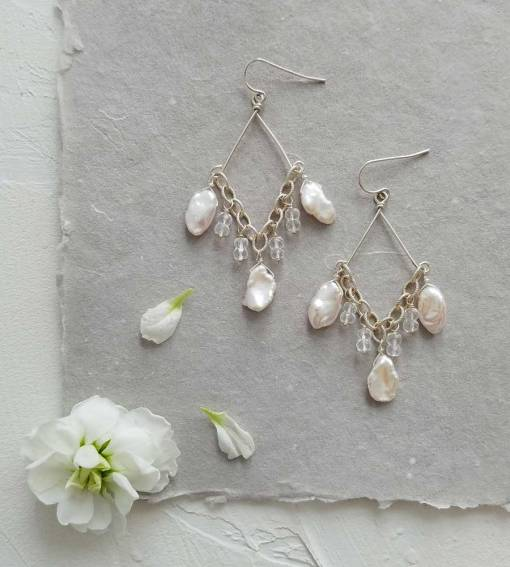 White pearl chandelier earrings handcrafted in sterling silver by Carrie Whelan Designs