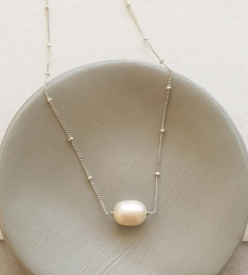 Single pearl choker necklace in sterling silver handmade by Carrie Whelan Designs