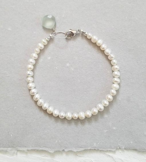 Dainty pearl bracelet with aqua gem accent handmade by Carrie Whelan Designs