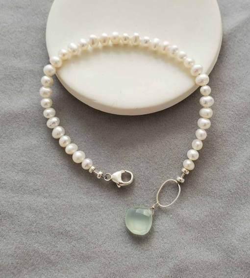 Handmade dainty freshwater pearl bracelet with aqua drop by Carrie Whelan Designs