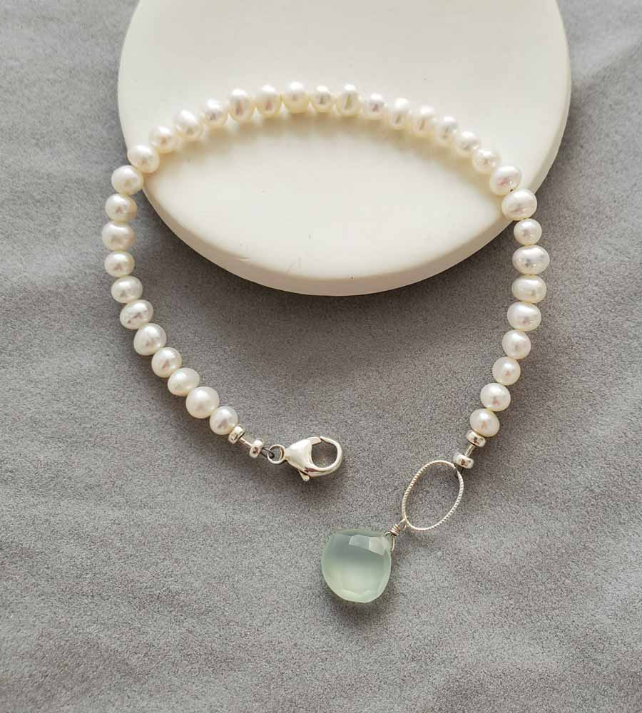 Handmade dainty freshwater pearl bracelet with aqua drop by Carrie Whelan Designs
