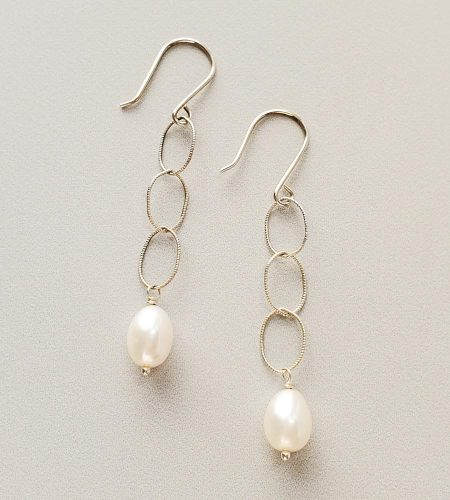 White oval pearl and chain earrings in sterling silver by Carrie Whelan Designs