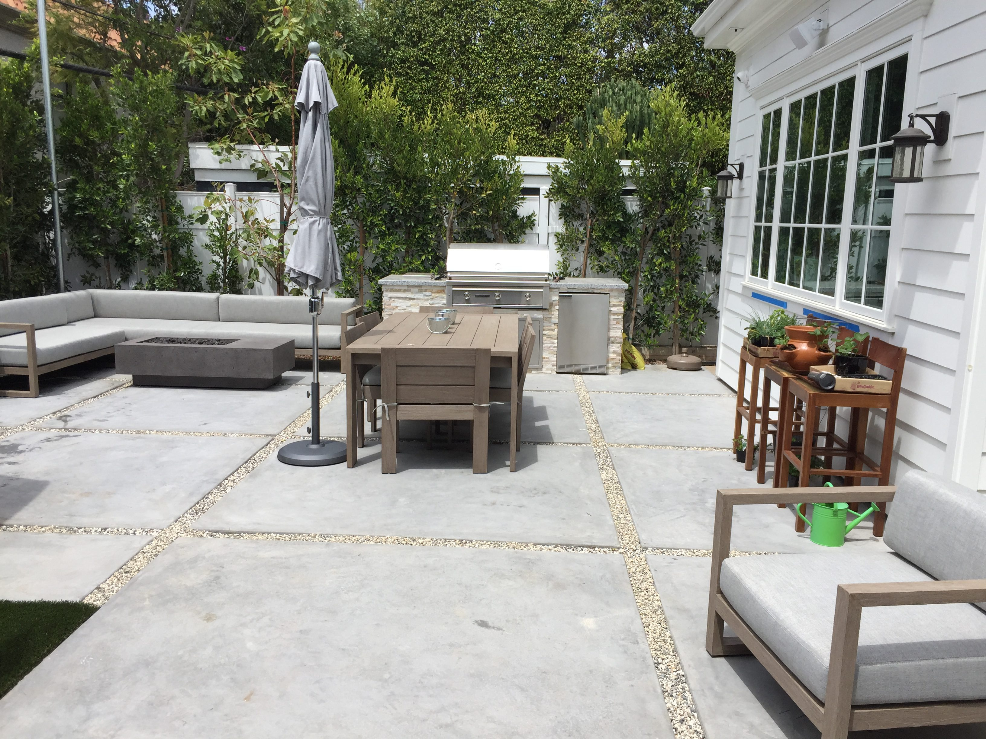"""Concrete squares with 4"""" gap for gravel completed in Pacific Palisades."""