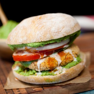 DELICIOUS Sweet Potato Falafel Burgers   An easy vegan dinner   Hearty healthy sandwich   Topped with parsley hummus and tahini   Mediterranean comfort food