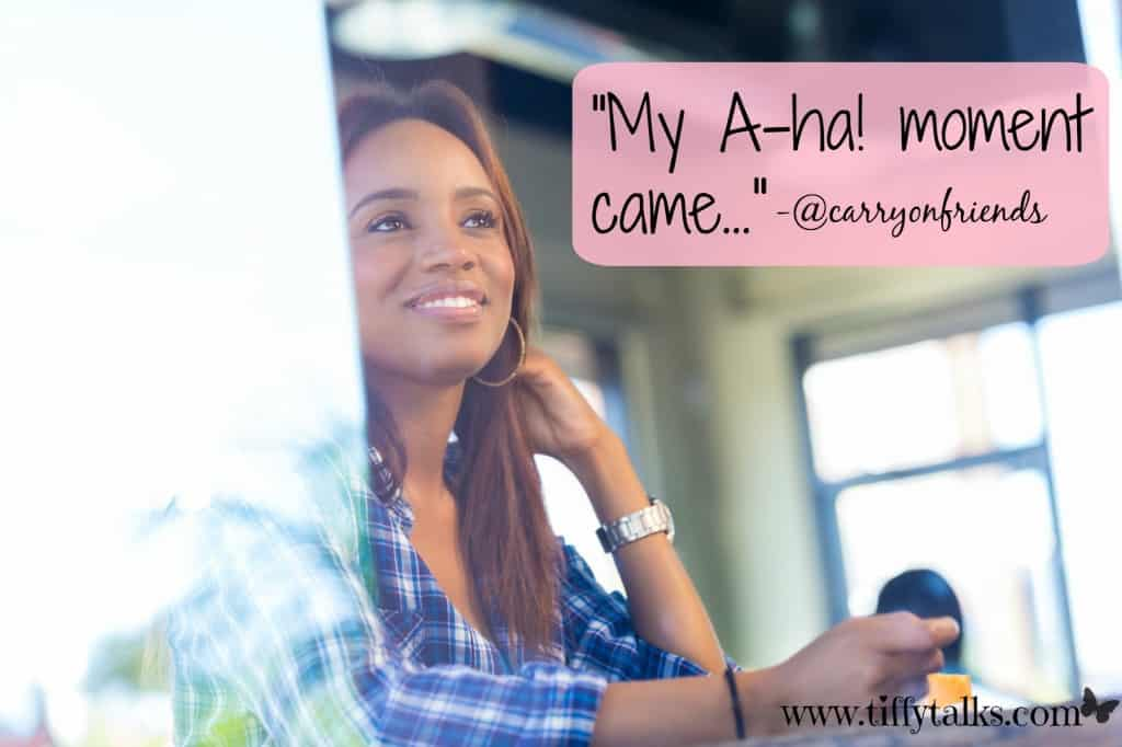 woman sitting with aha moment