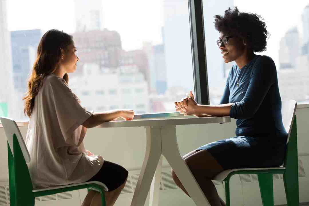 2 women of color working together