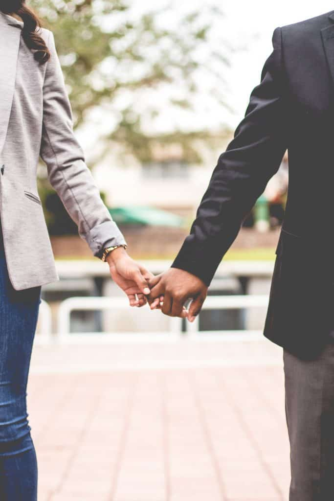 Couple of Color holding hands in Relationships and Business