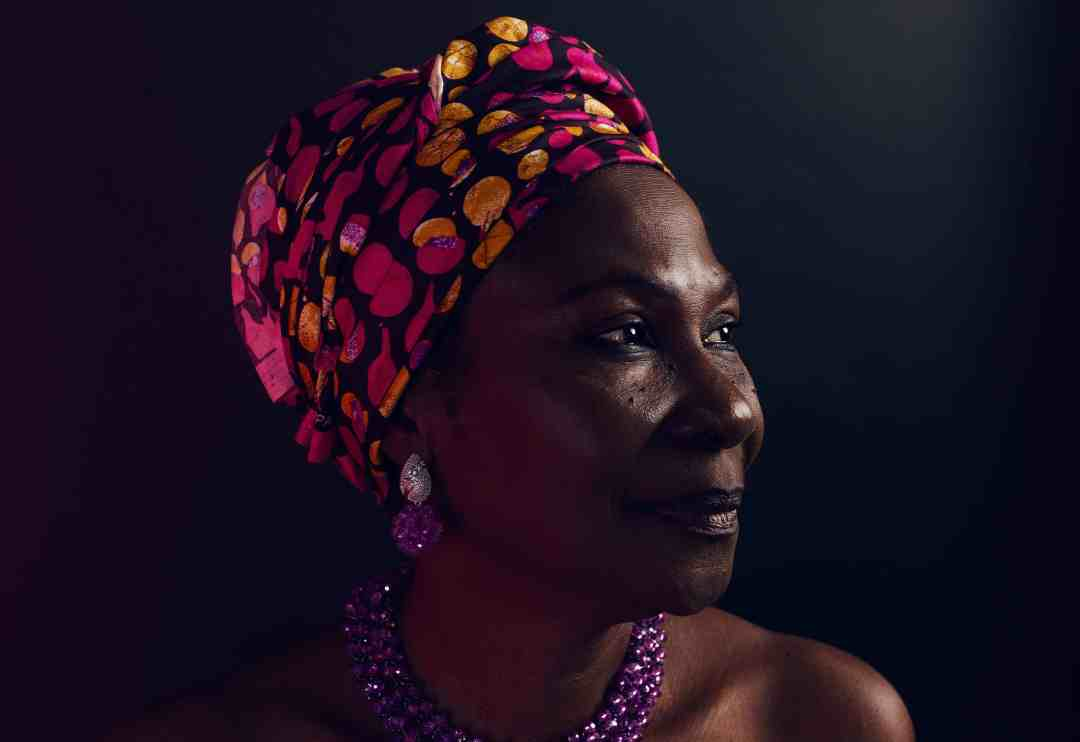 Woman of color with head wrap Celebrate Caribbean Woman History