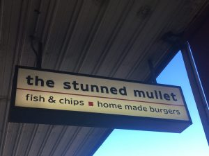 sign on the street for stunned mullet henley beach