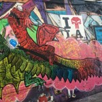 Sickid Paints a New Mural at the American Hotel in the Arts District
