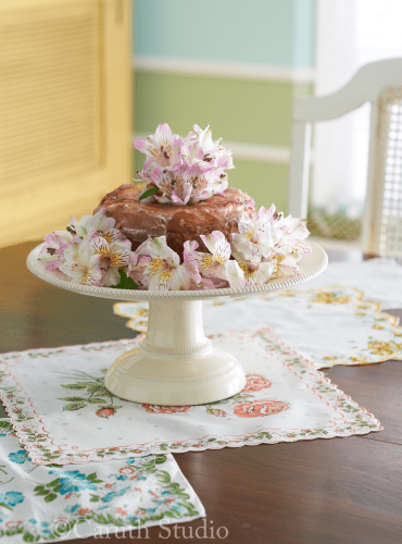 Cake on pedestal with flowers
