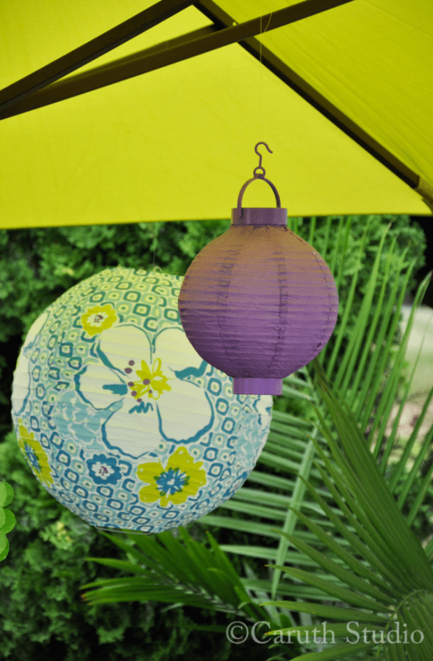 Paper lanterns under patio umbrella