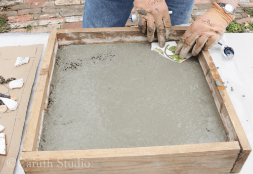 15 Place edging pieces in molded concrete