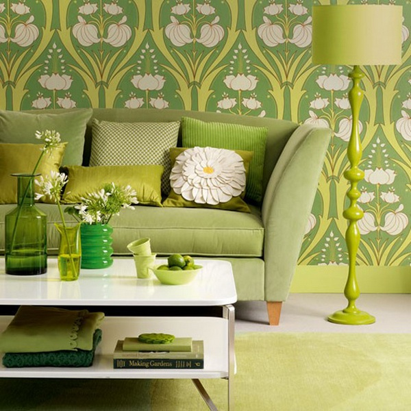 Ideal Home Green Room with green couch, lamp and white table