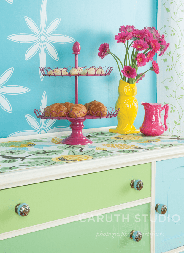 Painted sideboard top with pink and yellow accents