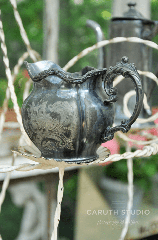 Etched silver pitcher