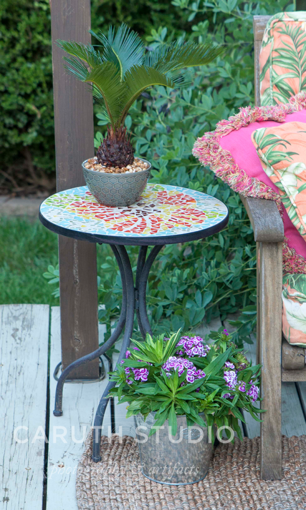 Side table on deck with mosaic flower top