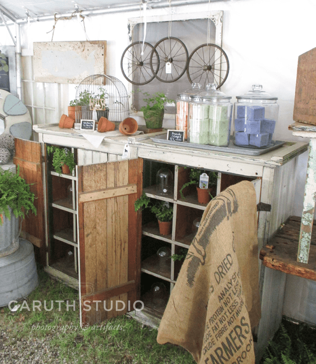 Brimfield antique cabinet and seed clothe