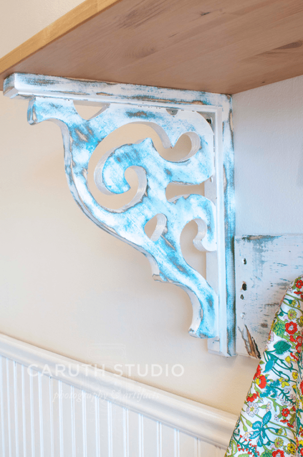 Attach corbels to wall