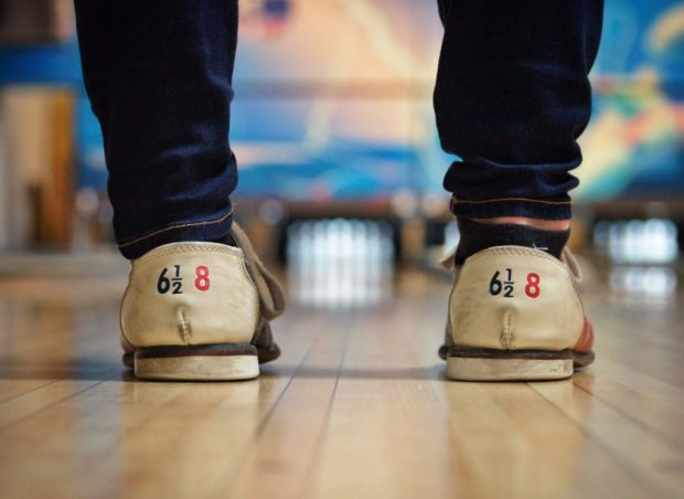 bowling shoes in front of bowling lane