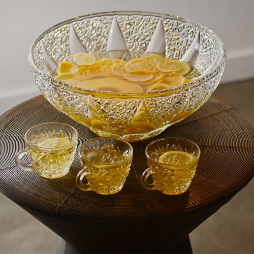 Canadian punch in a crystal bowl and three filled punch glasses