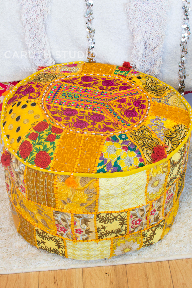 detail of the golden yellow poof table