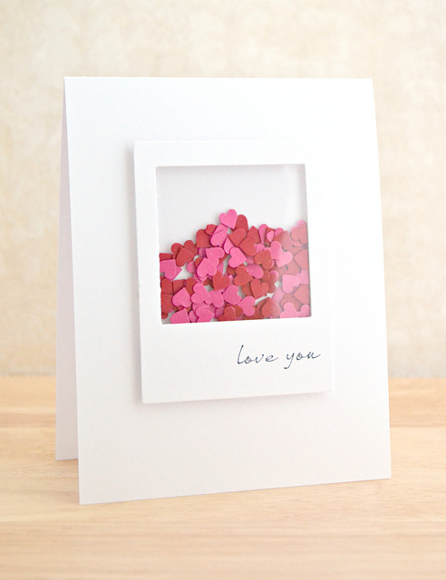 hearts shaker card with red and pink hearts in a window on the card