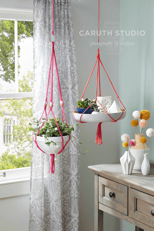 Macramé plant hangers in window