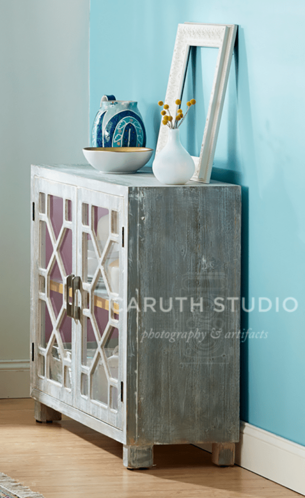 Blue accent wall behind dining room console