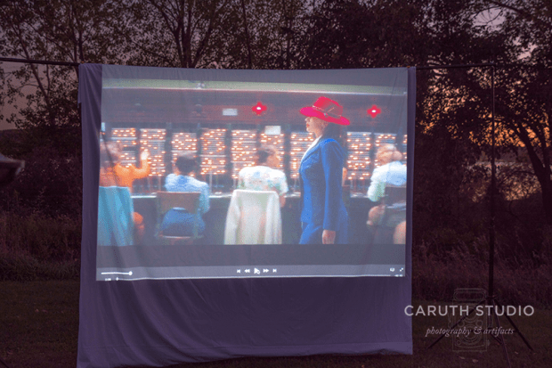 movie playing on an outdoor screen