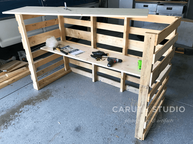 putting in a bar shelf for the pallet bar